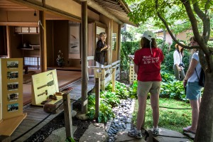 volunteer on the engawa of Shoin House