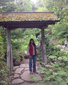 Elaine shows the donated gate at the UC-Berkeley pathway to the Japanese pond.