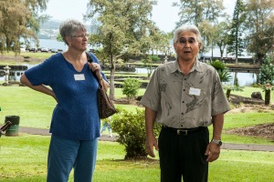 Della Allison Yamashiro of Friends of Lili`uokalani Gardens, listens to Hiroshi Suga, president of the Japanese Community Association of Hawaii, speak of cooperation to promote and preserve Japanese culture and foster harmony and fellowship in Hawaii County.