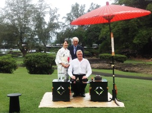 Dr. Sen congratulates Philippe Nault on four otemae (the artful performance of tea ceremony) outdoors in Lili`uokalani Gardens