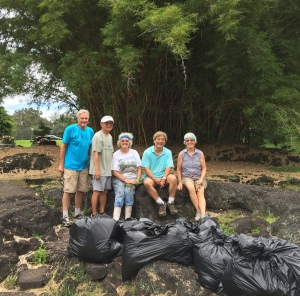 Board members were joined by Queen Lili`uokalani Children's Trust Hilo Children's Center director Lance Niimi and East Hawaii Master Gardener Daghild Rick, among others, for a test clearing of the bamboo thicket in June.