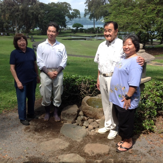 Clara Koga sensei, Takuhiro Yamada, Russ Oda and Amy Nishiura test the finished stone arrangement