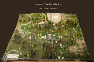 red ribbon marks size of original Japanese garden; model shows expansion completed in time for centennial