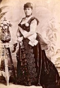 When she was Princess, Lili`uokalani accompanied Queen Kapi`olani to London for Queen Victoria's Jubilee. The black ribbon gown shown here recently was reproduced as part of the Ali`i Gown Project of Friends of `Iolani Palace. The gown was on display in Sangha Hall following the memorial service.