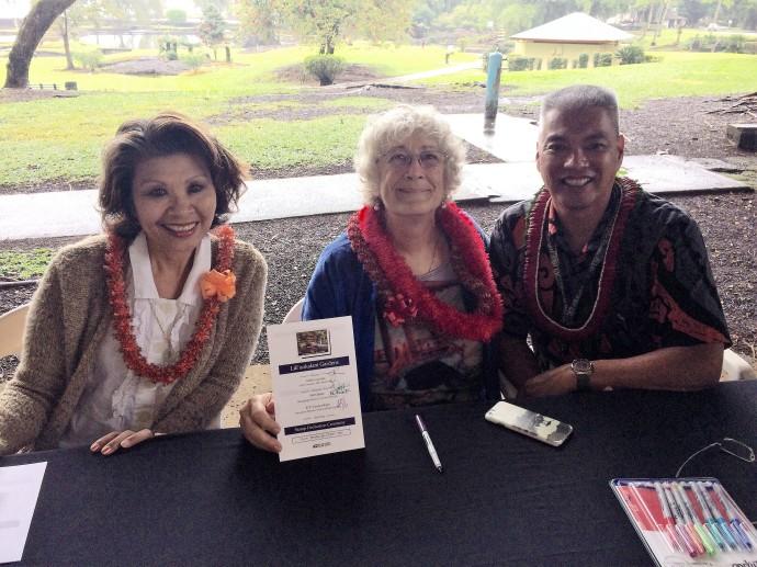 Rose Bautista, K.T. Cannon-Eger and Alton Uyetake sign programs for collectors photo by Barbara Fujimoto
